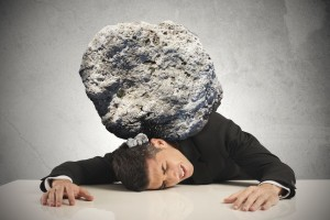 21139686 - stress of a businessman with a big rock