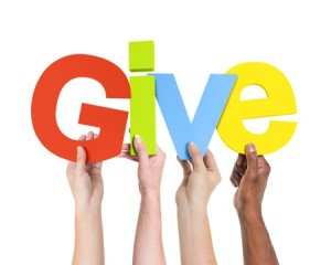 27154555 - multi-ethnic group of diverse people holding the word give