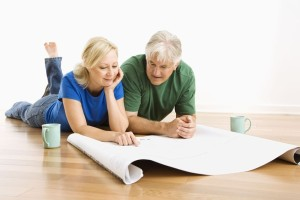 3557388 - middle-aged couple looking at architectural blueprints together.