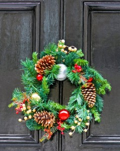 5952728 - conifer christmas wreath with pine cones at door