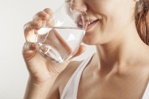 64786866 - young woman drinking  glass of water