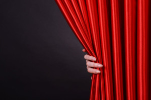 38217311 - red curtain on black background
