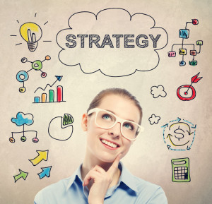 47808184 - strategy concept with young business woman wearing white eyeglasses