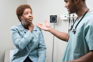 49818993 - woman talking to doctor
