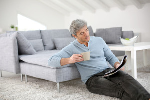 25762925 - senior relaxing at home and reading magazine