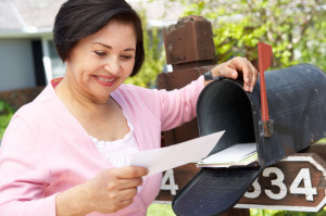 41512061 - senior hispanic woman checking mailbox