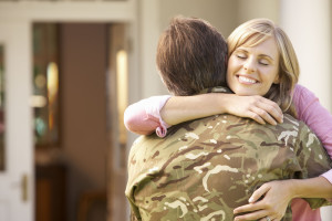 42248320 - soldier returning home and greeted by wife