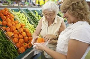 10555487 - volunteer helping senior with her shopping