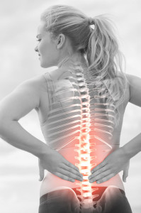42559742 - digital composite of highlighted spine of woman with back pain