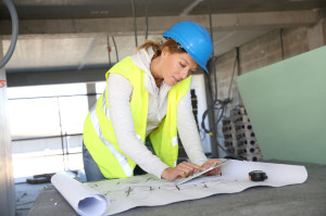 28354270 - woman architect on building site using tablet