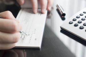 29909069 - business woman prepare writing a check