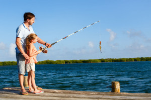 77385779 - family father and daughter fishing together from wooden jetty