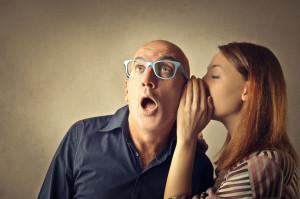 50740334 - teen whispering a secret