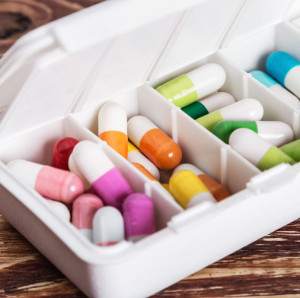 72396163 - pills of different colors in a box from under the medicines