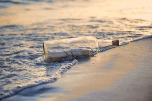 15705886 - message in a bottle on beach during sunset