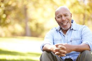 31053823 - senior man relaxing in autumn landscape