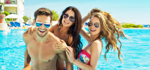 55096660 - beautiful friends having fun in swimming pool
