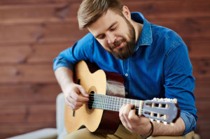 72881380 - young man composing music