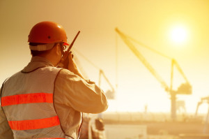 35391291 - worker with large crane site and sunset background