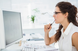 36327284 - focused businesswoman with glasses using computer in the office