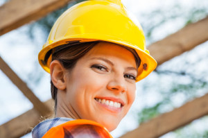 37542507 - smiling female construction worker at site