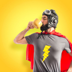 41310249 - super hero holding a cup of coffee