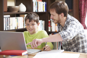 49362941 - boy studying with home tutor