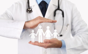 69457298 - medical health insurance concept, hands with family symbol