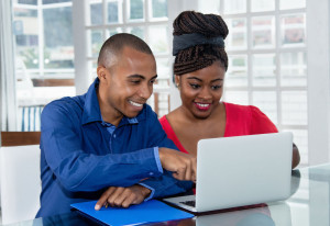 105799276 - african american couple at computer