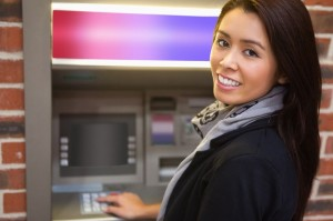 11184457 - woman withdrawing cash at an atm