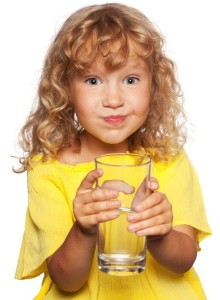 12470994 - child with a glass of water isolated on white