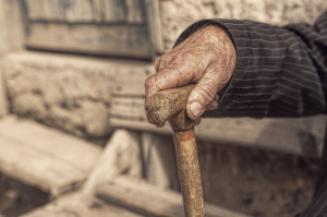 40896282 - hand of a old man holding a cane