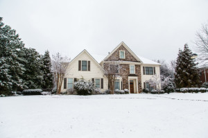 Nice Stone and Siding House After Heavy Snow