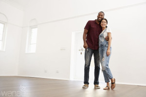 86206732 - excited young couple moving into new home together