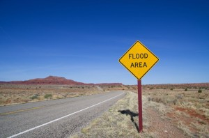 13091678 - horizontal image of flood area sign and road in the utah desert