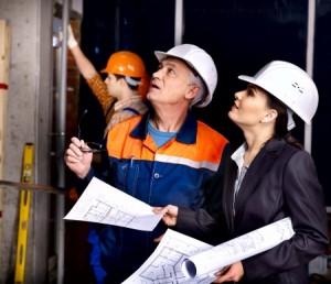 25226314 - business woman in builder helmet indoor.