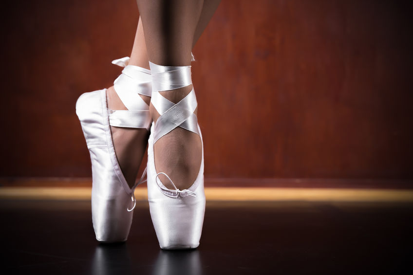 29722361 - young ballerina dancing, closeup on legs and shoes