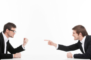 Men� confrontation. Two angry young business people shouting a