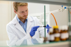 Laboratory assistant prepare instrument for experiment
