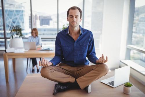 Executive meditating on desk