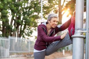 Senior woman stretching legs outdoor