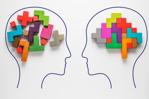 Heads of two people with colourful shapes of abstract brain
