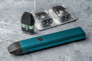 Vape pod system and replacement cartridges filled with e-juice or liquid with salt nicotine, new vape pen device, close up