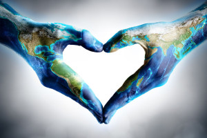 45044923 - earth's day celebration - hands shaped heart with world map