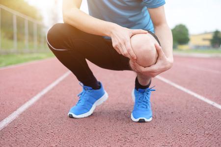 92990785 - running athlete feeling pain after having his knee injured