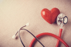 95130023 - red heart with stethoscope, heart health,  health insurance concept