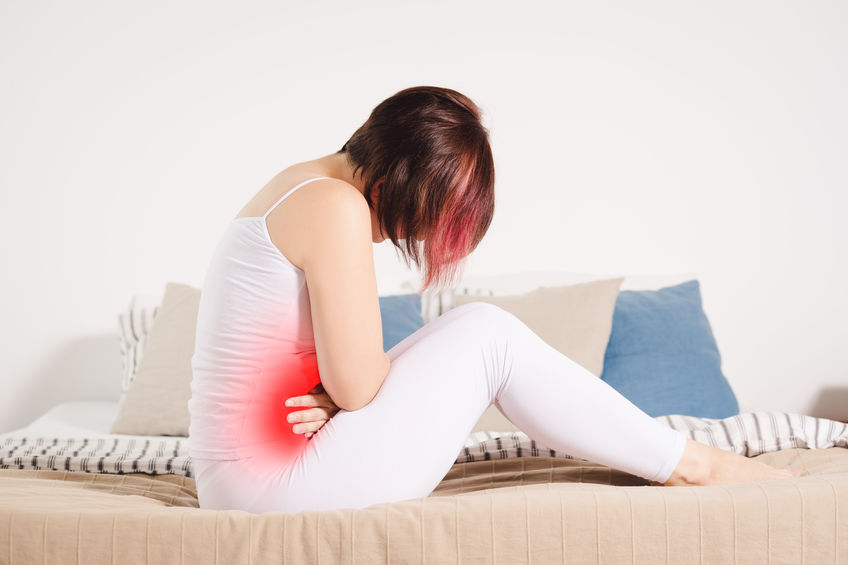 Stomach ache, woman with abdominal pain suffering at home