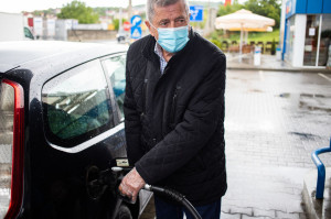 senior man at gas station wearing medical mask prevention measur