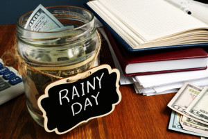 Rainy Day Fund label on the jar with money.